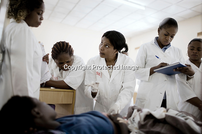 BUKAVU, DEMOCRATIC REPUBLIC OF CONGO - OCTOBER 29: Unidentified females nurses check on patients in a ward on October 29, 2007 at Panzi hospital outside Bukavu, DRC. Many of these women has been raped and abused by rebels and government soldiers. Many of the children are a result of rape. About 10 women and girls show up at the hospital every day and Dr. Denis Mukwege, a gynecologist and his staff does up to 20 reconstructive operations every day. He often has to perform complicated surgery to reproductive and digestive parts of the women. The DRC conflict has seen an unprecedented high rate of rape and sexual abuse of women. The culprits are both different rebel groups and government soldiers and very few are punished. About 27,000 sexual assaults were reported in South Kivu province alone in 2006, according to the United Nations. (Photo by Per-Anders Pettersson)