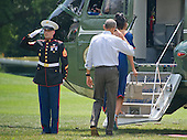 United States President Barack Obama salutes the Marien Guard as he and first lady Michelle Obama depart the White House in Washington, DC on Saturday, August 6, 2016 to travel to Martha's Vineyard, Massachusetts for their annual two week vacation.  <br /> Credit: Ron Sachs / Pool via CNP