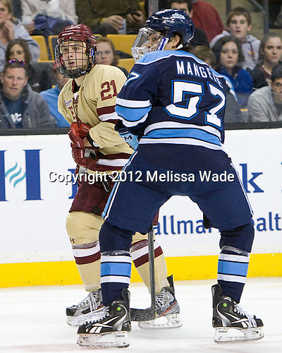 Steven Whitney (BC - 21), Matt Mangene (Maine - 57) - The Boston College Eagles defeated the University of Maine Black Bears 4-1 to win the 2012 Hockey East championship on Saturday, March 17, 2012, at TD Garden in Boston, Massachusetts.