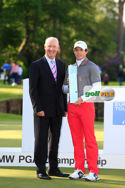 Tim Abbott, Managing Director of BMW UK with Rory MCILROY (NIR) who is the 2014 BMW PGA champion. The tournaments was played on the West Course, Wentworth Golf Club, Virginia Water, London.<br /> Picture: Fran Caffrey www.golffile.ie