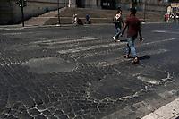 Rome, Italy, June 21, 2017. Un tratto di strada dissestata nel centro storico. A bumpy road in the center of the city.<br /> Ad un anno dalla elezione a sindaco di Roma di Virginia Raggi, la condizione di degrado non accenna a migliorare.<br /> One year after the election as mayor of the candidate of M5S party, Rome is worsening day by day.