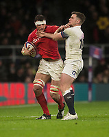 Wales' Aaron Shingler holds off Englands' George Ford<br /> <br /> Photographer Bob Bradford/CameraSport<br /> <br /> NatWest Six Nations Championship - England v Wales - Saturday 10th February 2018 - Twickenham Stadium - London<br /> <br /> World Copyright &copy; 2018 CameraSport. All rights reserved. 43 Linden Ave. Countesthorpe. Leicester. England. LE8 5PG - Tel: +44 (0) 116 277 4147 - admin@camerasport.com - www.camerasport.com