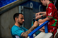 Leon Britton signs an autograph during the Pre-season friendly match between Birmingham City and Swansea City at St Andrew's Stadium, Birmingham, England, UK. 29 July 2017