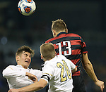 11 December 2015: Stanford's Jordan Morris (13) heads the ball over Akron's Danilo Radjen (left) and Brad Ruhaak (20). The Akron University Zips played the Stanford University Cardinal at Sporting Park in Kansas City, Kansas in a 2015 NCAA Division I Men's College Cup Semifinal match. The game ended in a 0-0 tie after overtime. Stanford advanced to the Final by winning the penalty kick shootout 8-7. (Photograph by Andy Mead/YCJ/Icon Sportswire)