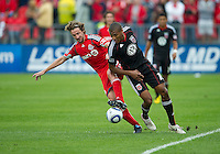 11 September 2010: D.C. United defender Jordan Graye #16 and Toronto FC forward Mista #10 in action during a game between DC United and Toronto FC at BMO Field in Toronto..DC United won 1-0..