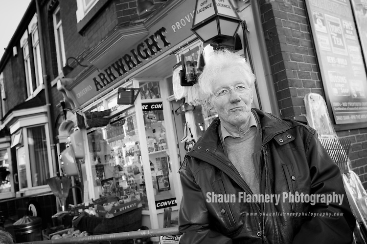 Pix: Shaun Flannery/shaunflanneryphotography.com<br /> <br /> COPYRIGHT PICTURE&gt;&gt;SHAUN FLANNERY&gt;01302-570814&gt;&gt;07778315553&gt;&gt;<br /> <br /> 19th November 2013.<br /> Open All Hours grocery shop at Lister Avenue, Balby, Doncaster, United Kingdom.<br /> The Lister Avenue hairdressers shop in Doncaster during the filming of the Open All Hours Christmas Special 2013.<br /> Open All Hours writer Roy Clarke outside Arkwright Store.