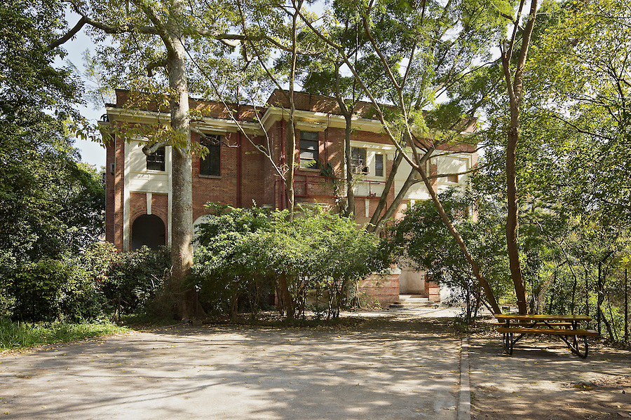 """Woodside, Hong Kong, completed in 1917.  Provided residences for two senior managers at the sugar plant or dockyard.  This image was taken in 2010 shortly before commencement a restoration project and Woodside's subsequent re-launch in May 2012 as a """"Biodiversity Education Centre""""."""