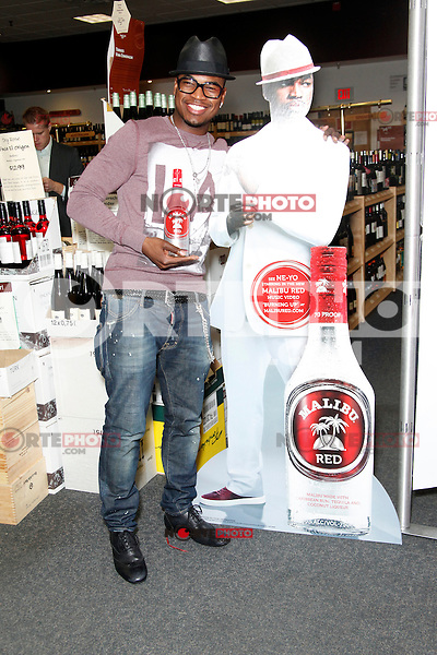 Serving as chief creative officer for Malibu's latest flavor innovation, Ne-Yo pictured in Philadelphiatoday signing pre-purchased bottles ofMalibu Red at PA Wine & Spirits Store on May 1, 2012  © Star Shooter / MediaPunchInc **SOLO*VENTA*EN*MEXICO**<br /> NORTEPHOTO:COM