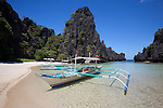 Bangka boats in the Small Lagoon on Miniloc Island, near El Nido, in the famous and beautiful Bacuit Archipelago in Palawan, Philippines.