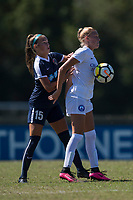 Sanford, FL - Saturday Oct. 14, 2017:  A Pride player brings the ball down from her chest while under pressure during a US Soccer Girls' Development Academy match between Orlando Pride and NC Courage at Seminole Soccer Complex. The Courage defeated the Pride 3-1.