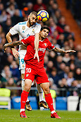 9th December 2017, Santiago Bernabeu, Madrid, Spain; La Liga football, Real Madrid versus Sevilla; Karim Benzema of Real Madrid Ever Banega of Sevilla FC, in action