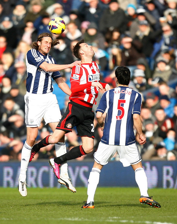 West Bromwich Albion's Jonas Olsson (L) and Sunderland's Steven Fletcher (C) in action during todays match  .. - Credit - CameraSport - Jack Phillips - .Football - Barclays Premiership - West Bromwich Albion v Sunderland - Saturday 23rd February 2013 - The Hawthorns - West Bromwich..© CameraSport - 43 Linden Ave. Countesthorpe. Leicester. England. LE8 5PG - Tel: +44 (0) 116 277 4147 - admin@camerasport.com - www.camerasport.com