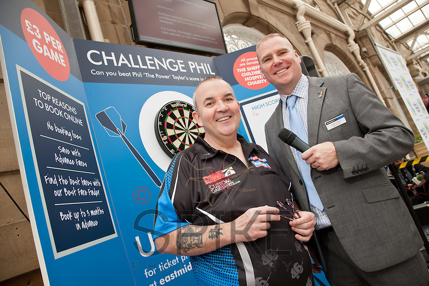 Phil 'The Power' Taylor raised money for The Children's Hospital Charity by challenging the public at darts at Sheffield Train Station Here Phil is pictured with Jason Cocker, Sheffield Train Station manager