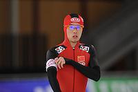 SCHAATSEN: BERLIJN: Sportforum, 06-12-2013, Essent ISU World Cup, 500m Men Division B, Xuefeng Li (CHN), ©foto Martin de Jong