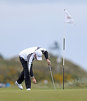 Friday 29th May 2015; Padraig Harrington, Ireland, repairs his pitch mark on the par 3 7th<br /> <br /> Dubai Duty Free Irish Open Golf Championship 2015, Round 2 County Down Golf Club, Co. Down. Picture credit: John Dickson / SPORTSFILE