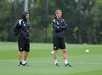 Swansea City manager Graham Potter (R) and Assistant Coach Bjorn Hamberg (L) during the Swansea City Training Session at The Fairwood Training Ground, Wales, UK. Tuesday 14th August 2018