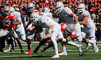 Maryland Terrapins quarterback Perry Hills (11) is sacked by Ohio State Buckeyes defensive lineman Tommy Schutt (90) during Saturday's NCAA Division I football game at Ohio Stadium in Columbus on October 10, 2015. Ohio State led 21-14 at the half. (Dispatch Photo by Barbara J. Perenic)