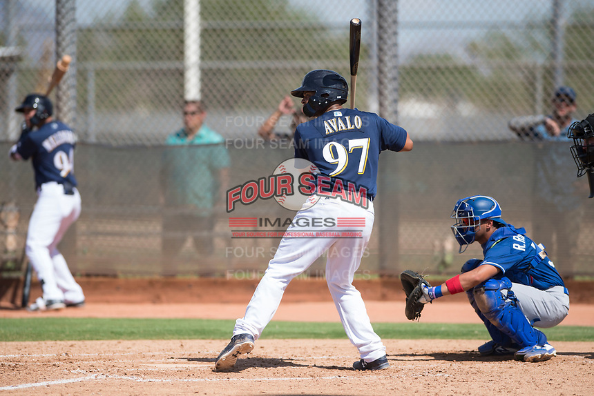 Milwaukee Brewers catcher Luis Avalo (97) at bat in front of catcher Ramon Rodriguez (55) during an Instructional League game against the Los Angeles Dodgers at Maryvale Baseball Park on September 24, 2018 in Phoenix, Arizona. (Zachary Lucy/Four Seam Images)