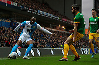 Blackburn Rovers' Ryan Nyambe crosses under pressure from Preston North End's Joe Rafferty<br /> <br /> Photographer Alex Dodd/CameraSport<br /> <br /> The EFL Sky Bet Championship - Blackburn Rovers v Preston North End - Saturday 11th January 2020 - Ewood Park - Blackburn<br /> <br /> World Copyright © 2020 CameraSport. All rights reserved. 43 Linden Ave. Countesthorpe. Leicester. England. LE8 5PG - Tel: +44 (0) 116 277 4147 - admin@camerasport.com - www.camerasport.com