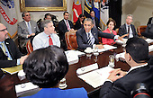 United States President Barack Obama meets with the Council of the Great City Schools Leadership in the Roosevelt Room of the White House March 16, 2015 in Washington, DC.  The purpose of the meeting is to discuss efforts to strengthen educational opportunities for students in city schools. Pictured at the President's right is U.S. Secretary of Education Arne Duncan.  At the President's left is Cecilia Muñoz, Director, White House Domestic Policy Council, and Shaun Donovan, Director, Office of Management and Budget.<br /> Credit: Olivier Douliery / Pool via CNP