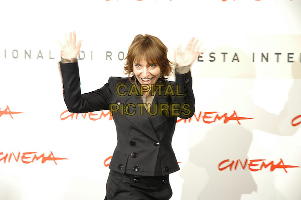 """USANNE BIER.Photocall for the film """"Things We Lost In The Fire"""" at the 2nd annual Rome Film Festival, Rome, Italy. .October 26rd, 2007  .half length black jacket skirt hands palms waving mouth open.CAP/CAV.©Luca Cavallari/Capital Pictures."""
