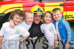 Children from the Shanakill Family Resource Centre Paddy O'Brien, Luke O'Connor, PJ Dowd, Ryan Hand and Killian O'Brien  met Fireman PJ Dowd  Feile na mBlath in Tralee Town Park on Friday.