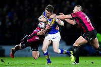 Picture by Alex Whitehead/SWpix.com - 08/03/2018 - Rugby League - Betfred Super League - Leeds Rhinos v Hull FC - Emerald Headingley Stadium, Leeds, England - Leeds' Richie Myler is tackled by Hull FC's Jordan Lane and Dean Hadley.