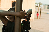 Africa, Sudan, Magwi County, Nimule, Southern Sudan - A young girl on the veranda at an orphanage in Nimule. The area is in the heart of Lord Resistance Amy territory. December 2005 © Stephen Blake Farrington