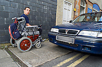 An illegally parked car preventing a wheelchair user from using the pavement and passing by. The car is parked on double yellow lines and the pavement. This image may only be used to portray the subject in a positive manner..©shoutpictures.com..john@shoutpictures.com