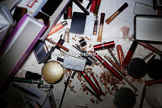 LAGOS, NIGERIA – DECEMBER 5: A table with makeup accessories during shows at Africa International Fashion Week, held at Oriental Hotel, Lagos Nigeria 2014. (Photo by: Per-Anders Pettersson)