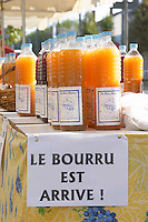 On a street market. Le bourru, half fermented grape juice. Bordeaux city, Aquitaine, Gironde, France