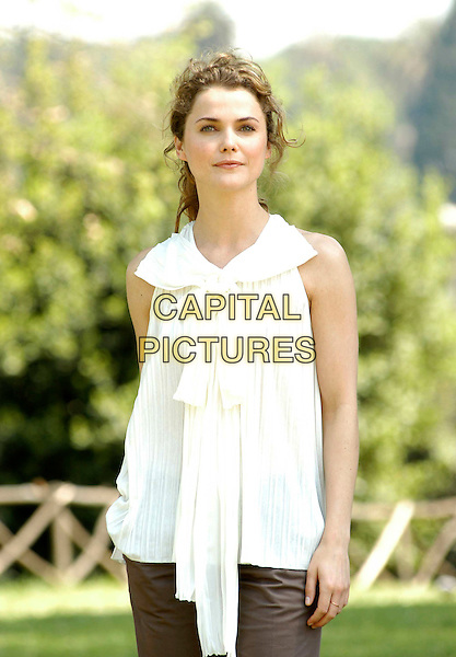 "KERI RUSSELL .Photocall for ""Mission Impossible 3"" at the Colosseum, Rome, Italy..April 24th, 2006                   .Ref: CAV.half length white top .www.capitalpictures.com.sales@capitalpictures.com.© Capital Pictures."