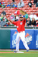 Buffalo Bisons first baseman Mauro Gomez #18 takes a throw during the first game of a double header against the Lehigh Valley IronPigs on June 7, 2013 at Coca-Cola Field in Buffalo, New York.  Buffalo defeated Lehigh Valley 4-3.  (Mike Janes/Four Seam Images)