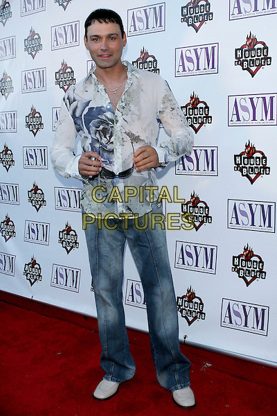 KRASSIMIR.13th Annual American Society Of Young Musicians Spring Benefit Concert and Awards Show held at the House Of Blues..June 9th, 2005.Photo credit: Jacqui Wong/AdMedia.full length jeans denim floral print blue and white sheer summery shirt sunglasses shades.www.capitalpictures.com.sales@capitalpictures.com.© Capital Pictures.