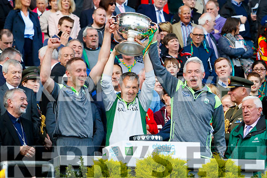 Tommy Griffin Trainer and Peter Keane manager and James Foley Trainer celebrate with the Tom Markham Cup after defeating Derry in the All-Ireland Minor Footballl Final in Croke Park on Sunday.