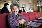 Sadako Koyama sits in the waiting room of Kyohei Takahashi's clinic in Minami-Soma, Fukushima Prefecture, Japan on 30 March, 2011. Despite being inside the 30 km exclusion zone, Koyama is among around 10,000 residents who either cannot or don't want to leave their homes. Photographer: Robert Gilhooly