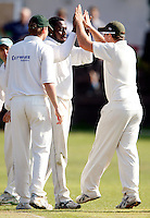 Jonathan Scantlebury (dark) of North London is high fived after dismissing K Jagannathan during the Middlesex County League Division three game between North London and South Hampstead at Park Road, Crouch End on Sat July 30, 2011