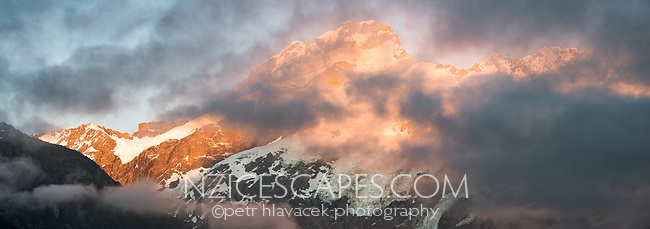 Dawn on Mount Sefton emerging from behind clouds, Aoraki Mount Cook National Park, UNESCO World Heritage Area, Mackenzie Country, South Island, New Zealand, NZ