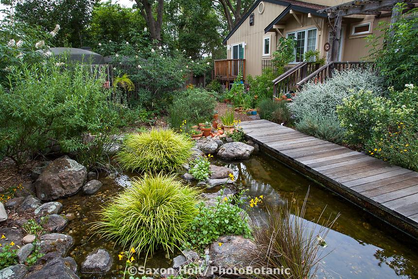 Cisterns with rain water harvest for backyard pond with boardwalk in Judy Adler Garden, Walnut Creek, California