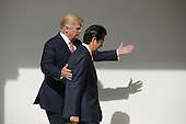 U.S. President Donald Trump and Japan Prime Minister Shinzo Abe walk together to their joint press conference in the East Room at the White House on February 10, 2017 in Washington, DC. Trump and Abe are expected to discuss many issues, including trade and security ties and will hold a joint press confrence later in the day. <br /> Credit: Chip Somodevilla / Pool via CNP