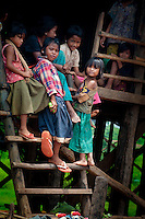 Girls hanging out on wooden steps to stilted out.
