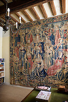 The stunning pre-Renaissance Flemish tapestry takes up most of one wall of the study