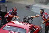 Jun 19, 2015; Bristol, TN, USA; Crew members for NHRA pro mod driver Doug Winters during qualifying for the Thunder Valley Nationals at Bristol Dragway. Mandatory Credit: Mark J. Rebilas-