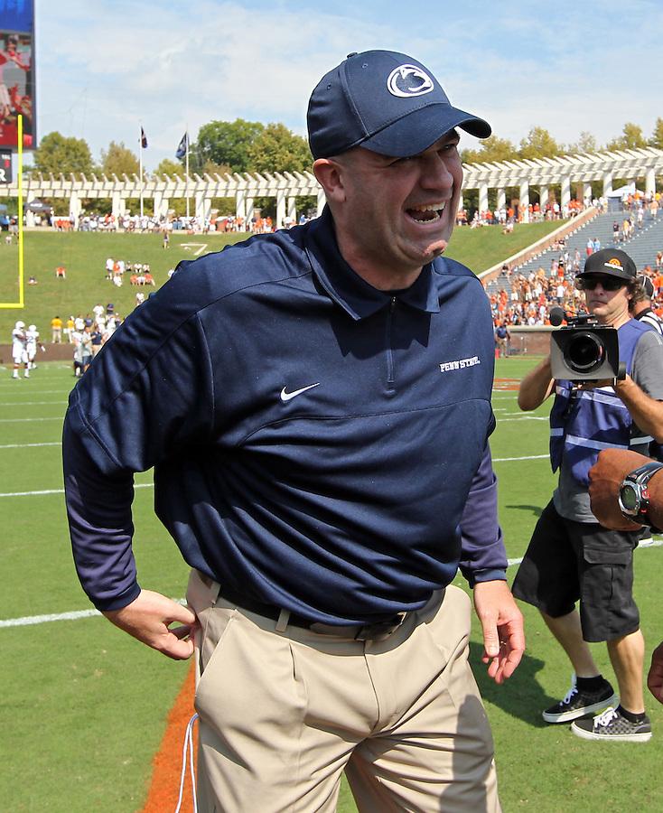 Penn State head coach Bill O'Brien has a laugh during an NCAA college football game against Virginia in Charlottesville, Va. Virginia defeated Penn State 17-16.