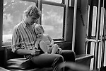 Father and baby child hot and humid weather parent bonding with new baby New Orleans, Louisiana 1969,