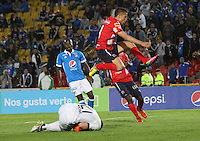 BOGOTA -COLOMBIA, 5-02-2017. Nicolas Vikonis (L) player of Millonarios  fights for the ball with John Hernandez (R) player of Independiente Medellin  during match for the date 1 of the Aguila League I 2017 played at Nemesio Camacho El Campin stadium . Photo:VizzorImage / Felipe Caicedo  / Staff