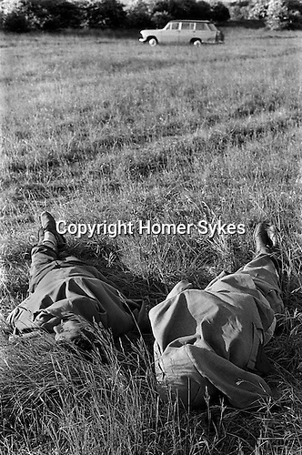 The Derby Epsom Downs, two drunks sleeping it off at the end of the days racing.