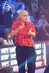 Burt Boutin reacts to winning a pot.