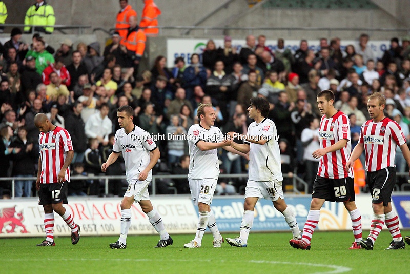 Pictured: Thomas Butler third scorer for Swansea (C) celebrating with team mates Ferrie Bodde (2nd L) and Jordi Gomez (4th L). <br /> Re: Coca Cola Championship, Swansea City Football Club v Southampton at the Liberty Stadium, Swansea, south Wales 25 October 2008.<br /> Picture by Mike Greenslade / Dimitrios Legakis Photography, Swansea, 07815441513