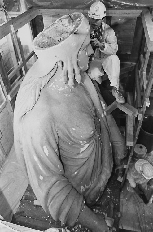 Plaster cast of Statue of Freedom (sculpted by those Crawford). After being buried somewhere at Smith Sonian. She was transported to Russell Senate Office Building where she is being cleaned up and restored to place in basement Rotunda area. Here a worker from architect's office working on her face on Oct. 5, 1992. (Photo by Maureen Keating/CQ Roll Call via Getty Images)
